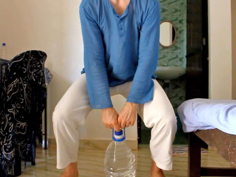 Exercise using bottle as kettle bell