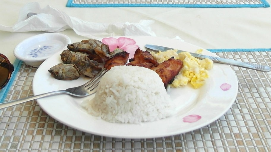 Typical pinoy breakfast with tocino, tinapa, eggs and rice