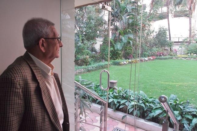 Dr.Prasanta Banerji in his office-watching the garden