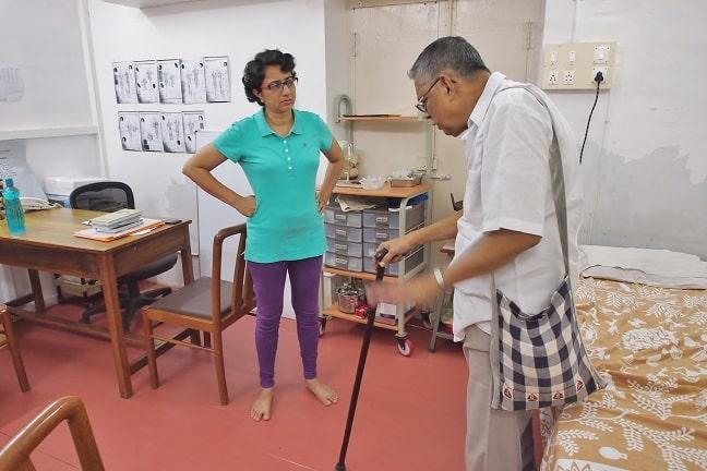 Akhila with patient at Sias healing centre-Pondicherry